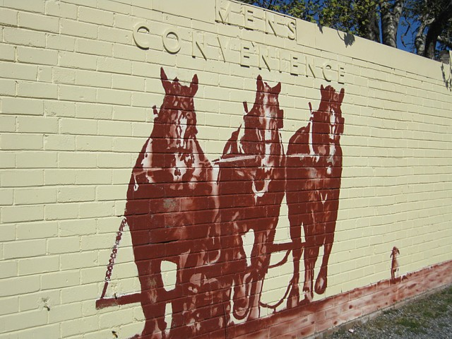 Team of Horses Ploughing - on the wall of the 'Mens Convenience'